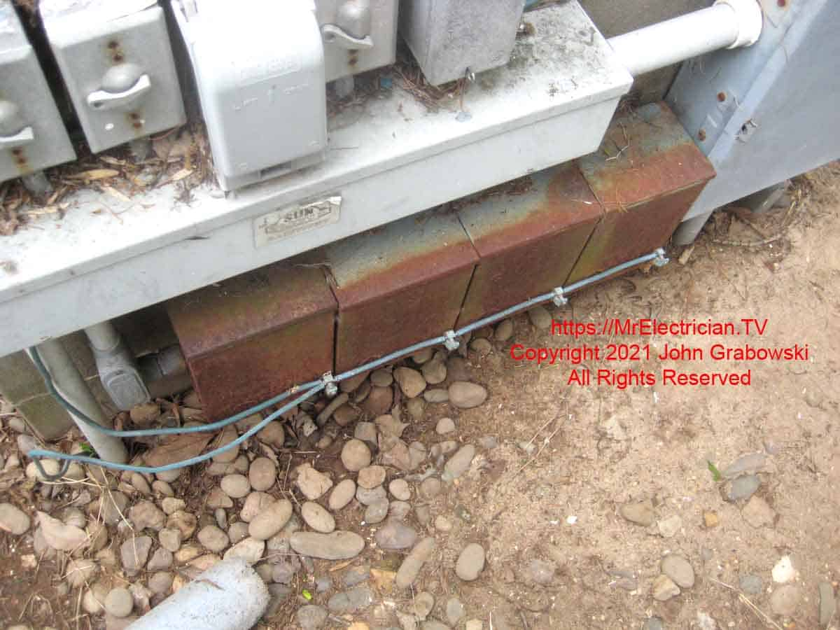 Swimming pool lighting transformers bonded to each other and other equipment