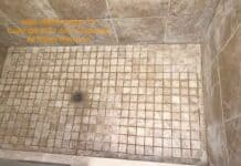 Existing shower floor with some of the grout removed